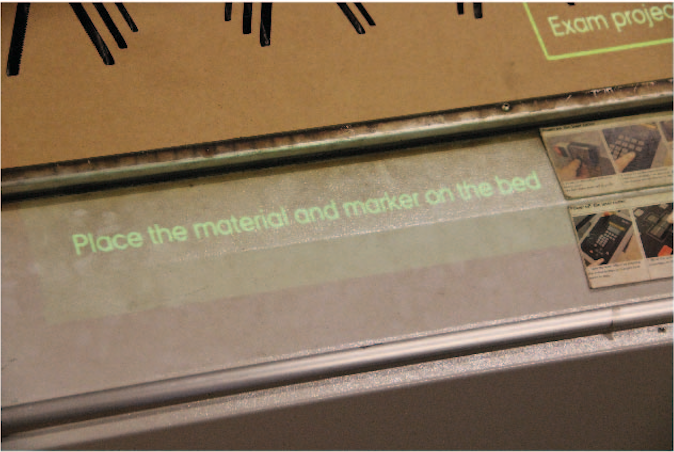 information projected on the laser cutter to guide the operator