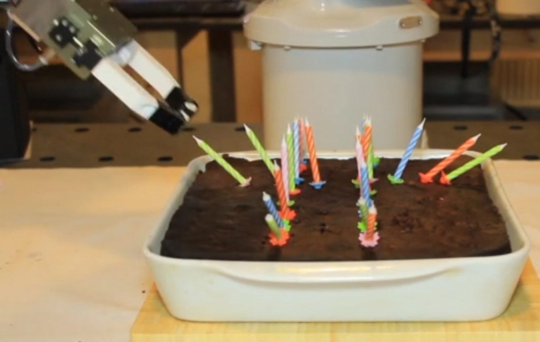 Robot placed birthday candles